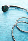 Shower on blue background — Stock Photo