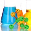 Molecule model and test tubes with colorful liquids close up — 图库照片