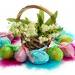 Beautiful easter eggs and lilies of the valley in basket , isolated on white — Stock Photo