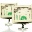 Dollars folded into computer monitors isolated on white — Stock Photo