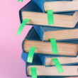 Many books with bookmarks on pink background close-up — Stock Photo #24277829