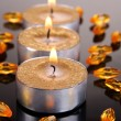 Stock Photo: Golden candles isolated on black