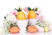 Easter candles with flowers isolated on white — Stock Photo