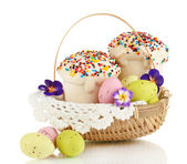 Easter cakes with eggs in wicker basket isolated on white — Stok fotoğraf
