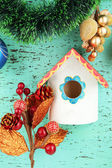 Nesting box and Christmas decoration — Stock Photo