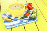 Diet soup with vegetables in cup on green wooden table close-up — Stock Photo