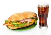 Tasty ham sandwich and glass of cola with ice isolated on white — Stock Photo