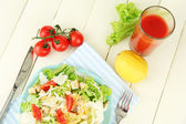 Caesar salad on blue plate, on color wooden background — Stock Photo