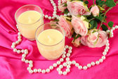 Candle on pink fabric close -up — Foto Stock