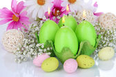 Easter candles with flowers close up — Стоковое фото