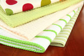 Kitchen towels on wooden background — Stock Photo