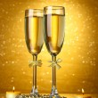 Royalty-Free Stock Photo: Two glasses of champagne on bright background with lights