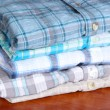 Shirts neatly folded close-up - Stock Photo