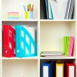 White office shelves with different stationery, close up — Stock Photo #24281769