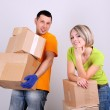 Young couple moving in new house — Stock Photo #24282121