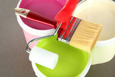 Set for painting: paint pot, brushes, paint-roller on grey background — Stockfoto