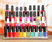 Bright nail polishes on shelf in beauty salon — Stock Photo