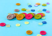 Bright color buttons on a blue background — Stock Photo