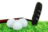 Golf balls and driver on grass isolated on white — Stock Photo