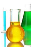 Provrör med färgglada vätskor isolerad på vit — Stockfoto