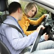 Learner driver student driving car with instructor — Stok fotoğraf