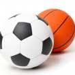 Basketball and football balls isolated on white — Stock Photo #24407107