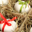 Decorative Easter eggs in wooden basket close up — Photo