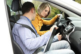 Learner driver student driving car with instructor — Stock Photo