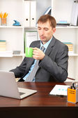 Young businessman at lunch break in office — Stock Photo