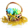 Easter eggs in basket and mimosflowers, isolated on white — Stock Photo #24414333