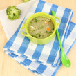 Diet soup with vegetables in pan on wooden table close-up - Stock Photo