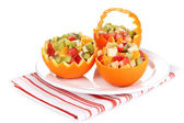 Fruit salad in hollowed-out orange isolated on white — Stock Photo