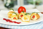 Egg rolls with cheese cream and paprika,on plate, on bright background — Stock Photo