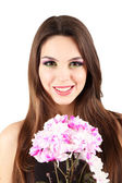 Young beautiful girl with nice flowers in her hand, isolated on white — Stok fotoğraf