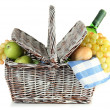 Picnic basket with fruits and bottle of wine, isolated on white — Stock Photo #24455003