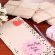 Writing letter of congratulations to mother's Day on wooden table close-up - Stockfoto
