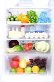 Refrigerator full of food — Stock Photo