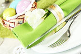 Easter table setting on color background — Stock Photo