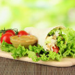 Kebab - grilled meat and vegetables, on bamboo mat, on bright background - Foto de Stock