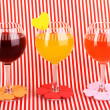 Royalty-Free Stock Photo: Colorful cocktails with bright decor for glasses on red background with stripes