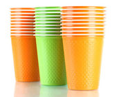 Cups in different color isolated on white — Stock Photo