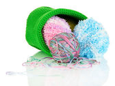 Colorful yarn for knitting in green basket isolated on white — Stok fotoğraf
