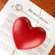 Red heart with torn Divorce decree document, on wooden background close-up — Stock Photo