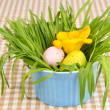 Easter eggs in bowl with grass on table close up — Stock Photo