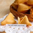 Fortune cookies on wooden table — Stock Photo #24507041