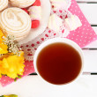 Stock Photo: Beautiful composition with cup of teand marshmallow on wooden picnic table close-up