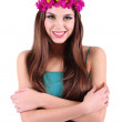 Young beautiful girl in green dress with bright wreath on her head, isolated on white — Stock Photo