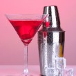 Cocktail shaker and cocktail on red background — Stock Photo #24509775