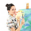 Beautiful young woman painter at work, isolated on white — Stock Photo #24509925