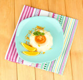 Panna Cotta with orange zest and caramel sauce, on wooden background — Stock Photo